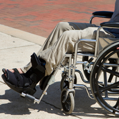 Man in Wheelchair with Broken Foot