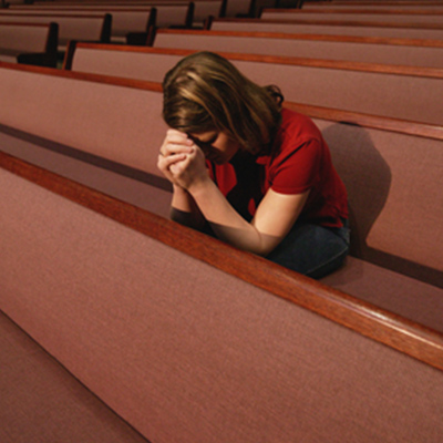 Woman Grieving in Church